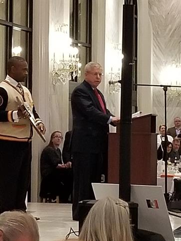 Joe Power, Jr. accepts his 2018 Leo Man of the Year award.