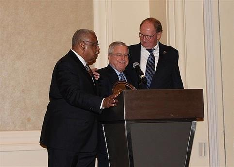 Joseph R. Power Jr. (center) receives the Illinois Trial Lawyers Association's Leonard Ring Lifetime Achievement Award while being congratulated by fellow Power Rogers & Smith, L.L.P. partner Larry R. Rogers Sr. (left) and Thomas Q. Keefe Jr (right).